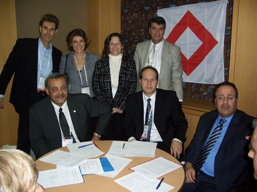 Seoul, Korea 2005. At the signing ceremony: Uri Geller, Anna Segall, Federation Representative in Israel. Yael Ronen, International Legal Advisor. Moshico Elbaz, Member of the Board, Magen David Adom Younis Al-Khatib, President Palestine Red Crescent Society. Dr. Noam Yifrach, President, Magen David Adom. Dr. Mohammed Al-Hadid, Chairman, Standing Commissioner of the Red Cross and Red Crescent.