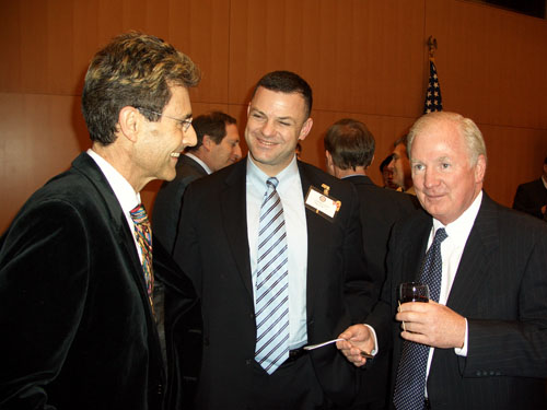 Geneva, Switzerland 2005. US Ambassador Kevin E. Moley and Lieutenant Colonel United States Marine Corps David Gurfein having a conversation with Uri Geller.