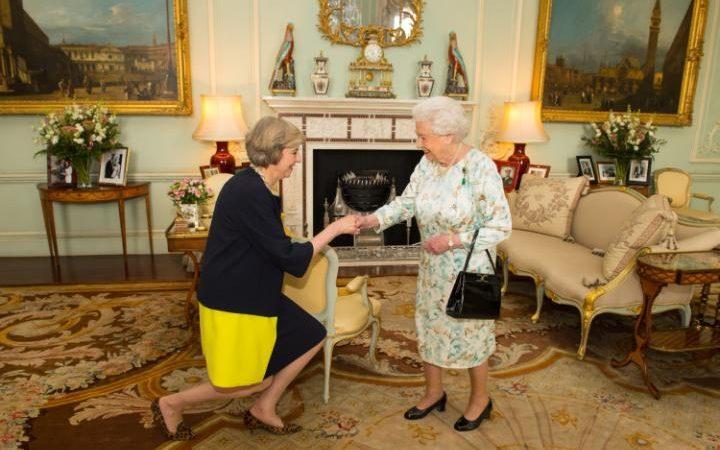 Queen Elizabeth II welcomes Theresa May