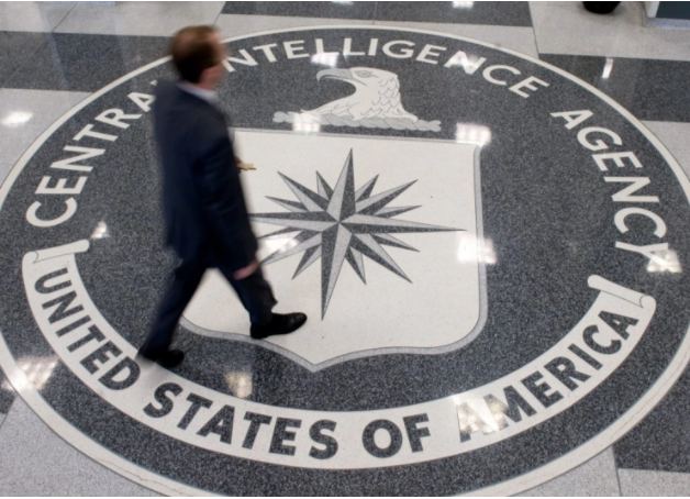 A man walks across the CIA logo in the lobby of the agency's headquarters in Langley, Va. (Saul Loeb/AFP/Getty Images)